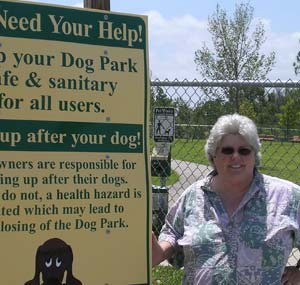 Dr. Glasser - Dog Park Consultant - Next to Dog Park Rules Sign